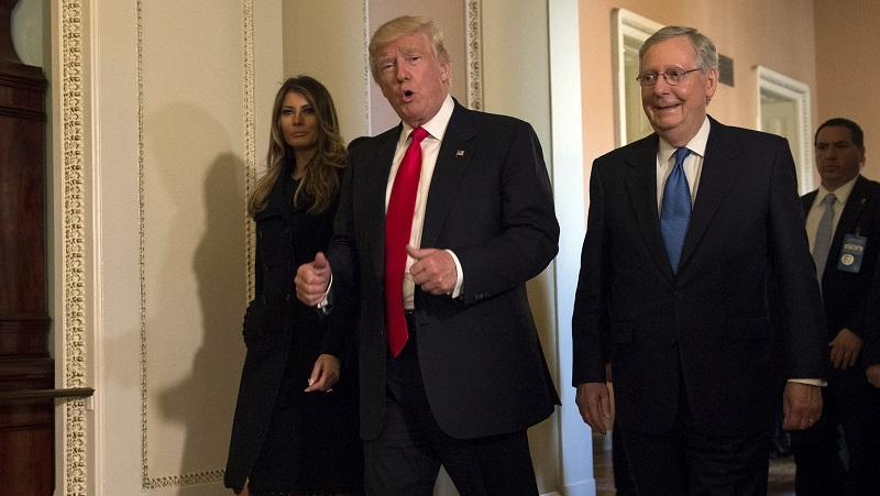 Donald Trump with wife Melania and Mitch McConnell